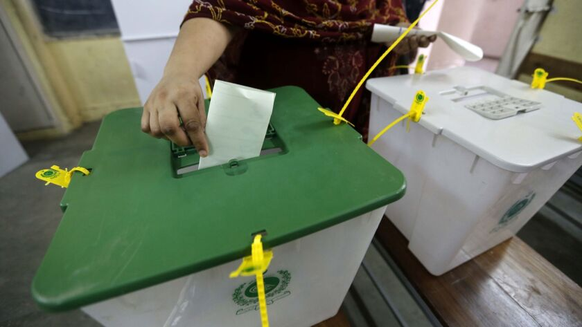 A woman casts her ballot during parliamentary elections in Pakistan on July 25 .