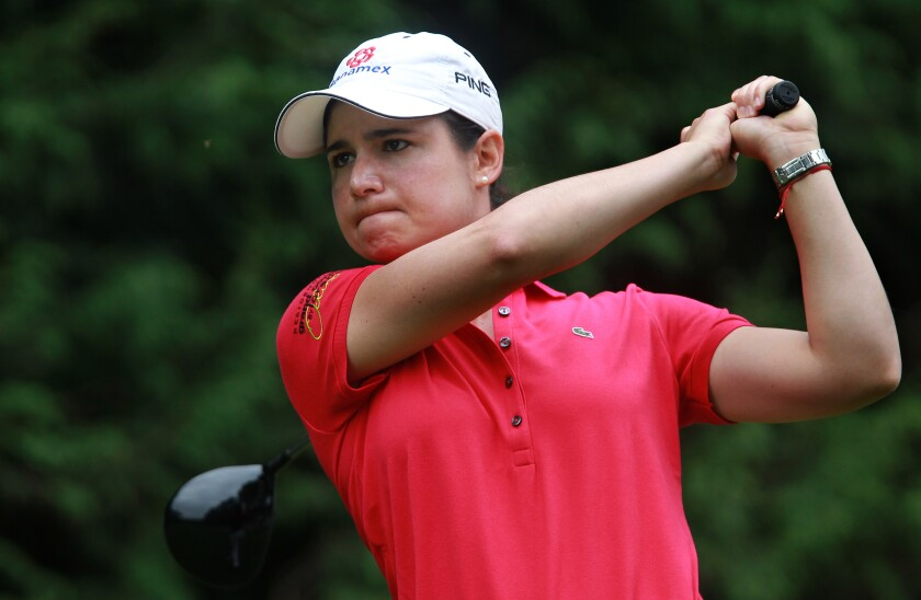 Lorena Ochoa of Mexico tees off on the 18th hole during the women's Lacoste Open.