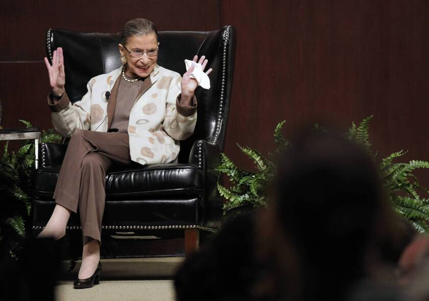 U.S. Supreme Court Justice Ruth Bader Ginsburg reacts to the audience while being introduced before a discussion about Roe V. Wade at the University of Chicago Law School in 2013.