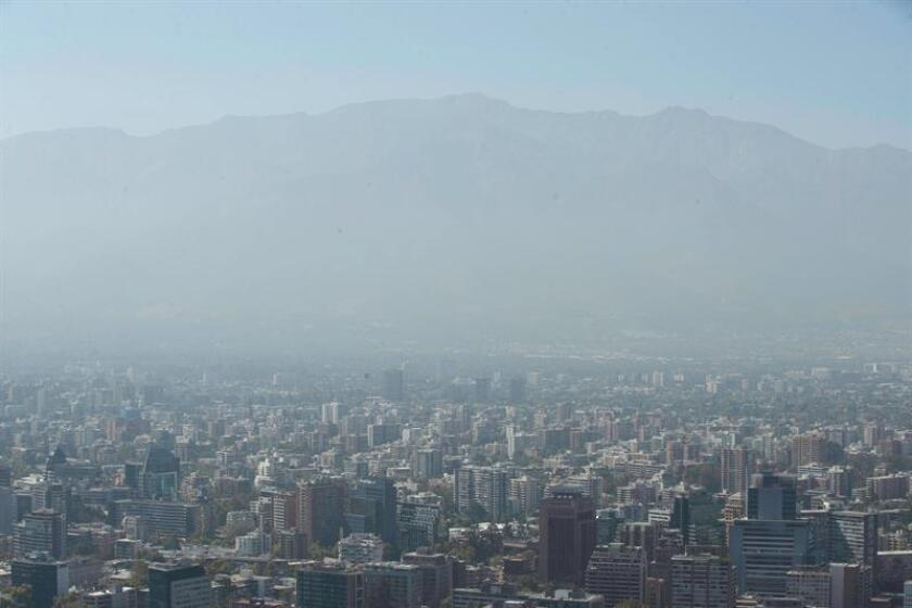 Air pollution obscures buildings and houses in the city of Santiago, Chile, on March 15, 2019. EPA-EFE/Alberto Valdes
