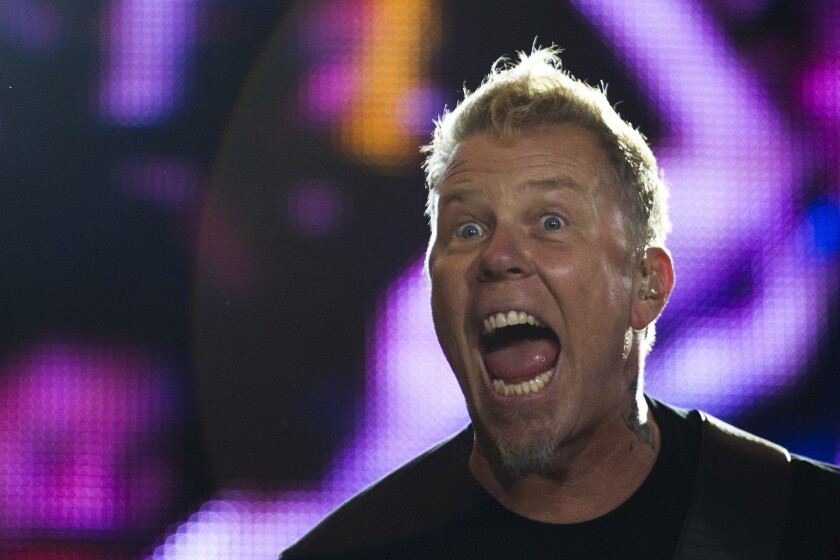 James Hetfield of Metallica performs during the Rock in Rio music festival in Rio de Janeiro, Brazil, Monday, Sept. 26, 2011. The festival, which runs through Oct. 2, includes performances by Katy Perry, Rihanna, Stevie Wonder, Red Hot Chili Peppers, Metallica, Guns N' Roses and Coldplay. (AP Photo/Felipe Dana)