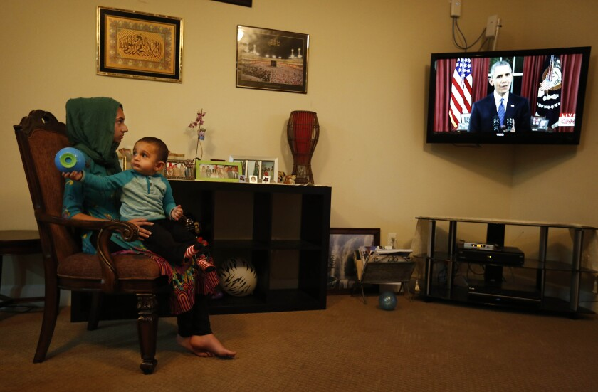 The Zafarullah family of Chino, originally of Pakistan, watches Obama's address. Arshia, at left, is holding her 18-month-old nephew, Sohail Ahmed.