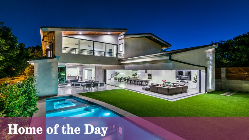 Situated on a gentle knoll in Cheviot Hills, this new-construction, contemporary home offers indoor-outdoor living and treetop views.