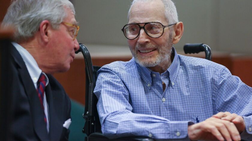 New York real estate scion Robert Durst has a lighter moment with one of his attorneys, Dick DeGuerin, while appearing in Los Angeles court earlier this year for a hearing in his murder case.