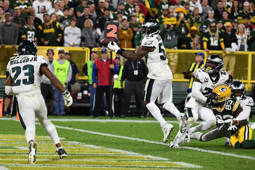 Philadelphia Eagles' Nigel Bradham (53) intercepts a pass in the endzone during the fourth quarter against the Green Bay Packers at Lambeau Field on Thursday in Green Bay, Wisc.
