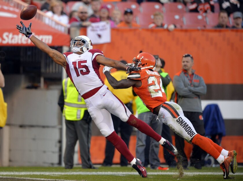 Arizona Cardinals wide receiver Michael Floyd (15) jumps but can't catch the ball under pressure from Cleveland Browns cornerback Johnson Bademosi (24) in the second half of an NFL football game, Sunday, Nov. 1, 2015, in Cleveland. (AP Photo/David Richard)