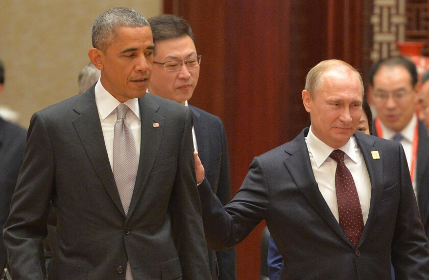 Who's the big cheese now? U.S. President Barack Obama and Russian President Vladimir Putin in a rare personal encounter at November's APEC summit in Beijing.