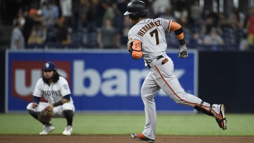 The Giants' Gorkys Hernandez rounds the bases after hitting a solo home run during the 12th inning of a baseball game against the San Diego Padres at Petco Park on July 30, 2018 in San Diego, California.