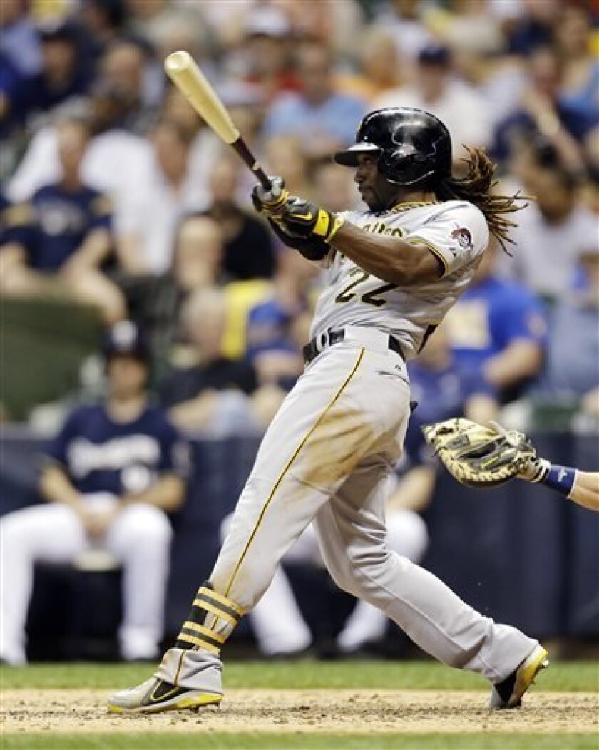 Pittsburgh Pirates' Andrew McCutchen watches his home run against the Milwaukee Brewers during the fifth inning of a baseball game, Tuesday, April 30, 2013, in Milwaukee. (AP Photo/Jeffrey Phelps)