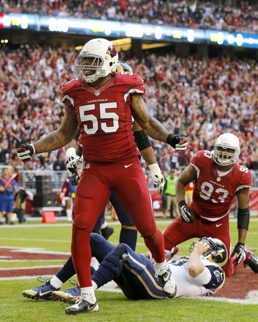 Arizona Cardinals outside linebacker John Abraham (55) cekebrates after sacking St. Louis Rams quarterback Kellen Clemensm right, in the end zone for a safety as teammate Calais Campbell (93) looks on during the second half of an NFL football game, Sunday, Dec. 8, 2013, in Glendale, Ariz. (AP Photo/Matt York)