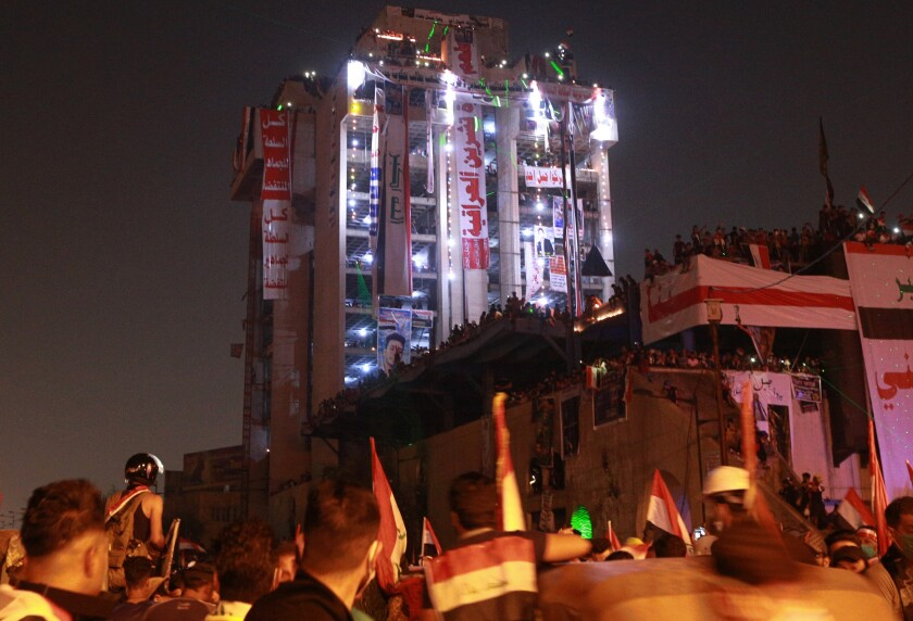 APphoto_Iraq Protesters Tower