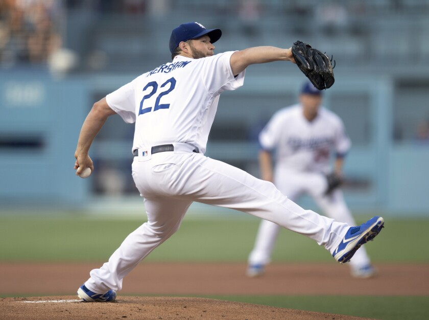 Los Angeles Dodgers starting pitcher Clayton Kershaw throws during the first inning of the team's ba