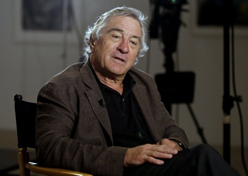 FILE - In this June 11, 2014 file photo, actor Robert De Niro is interviewed by Chris Wallace at the DC Moore Gallery, in New York. The prime minister of Antigua & Barbuda has appointed De Niro as special economic envoy of the twin-island nation in the eastern Caribbean. (AP Photo/Richard Drew, File)