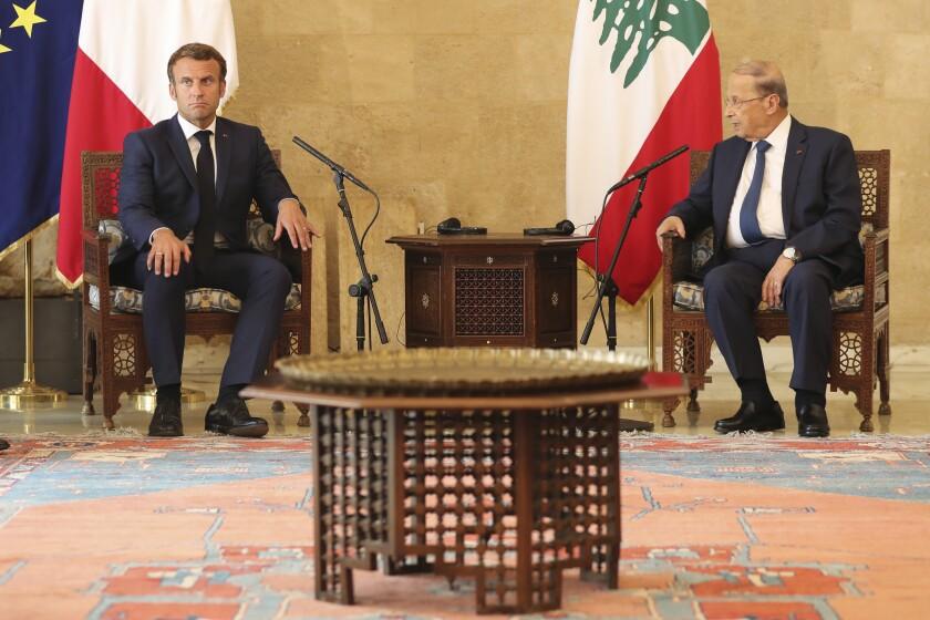 French President Emmanuel Macron, left, and Lebanese President Michel Aoun meet Thursday in Beirut.