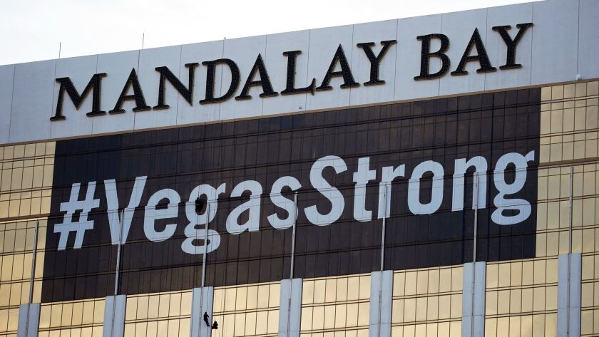 Workers install a #VegasStrong banner on the Mandalay Bay Resort and Casino in Las Vegas. Stephen Paddock opened fire from the hotel on an outdoor country music concert, killing 58 and injuring hundreds.
