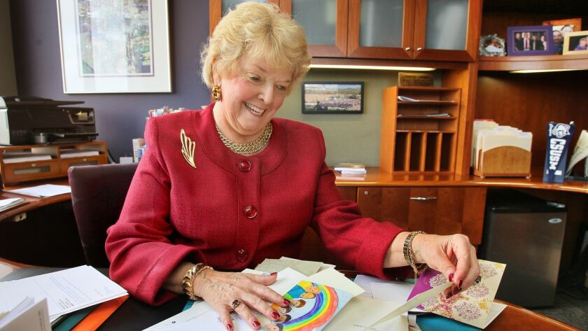 In this 2014 photo, Cal State San Marcos President Karen Haynes pages through thank you cards and letters from past students.
