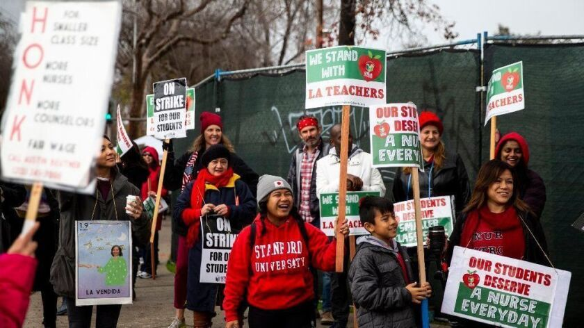 Educators, parents and others picket in support of UTLA at Eagle Rock Junior/Senior High School on Tuesday.
