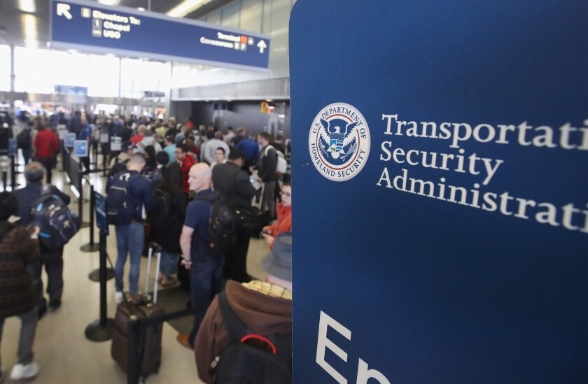 Passengers at Chicago's O'Hare International Airport wait in line to be screened at a TSA checkpoint on May 16.