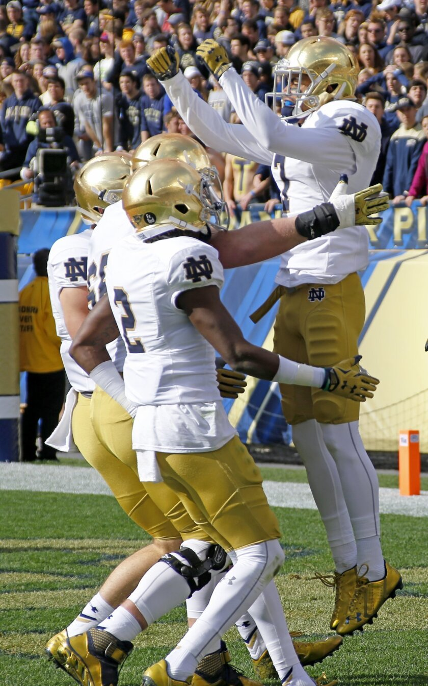 Notre Dame wide receiver Will Fuller, right, celebrates with teammates after scoring a touchdown on a pass play in the first quarter of an NCAA football game against Pittsburgh, Saturday, Nov. 7, 2015 in Pittsburgh. (AP Photo/Keith Srakocic)