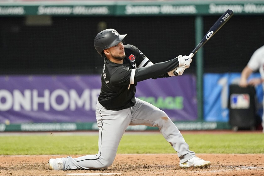 Chicago White Sox's Nick Madrigal strikes out swinging in the seventh inning of the second baseball game of a doubleheader against the Cleveland Indians, Monday, May 31, 2021, in Cleveland. The Indians won 3-1. (AP Photo/Tony Dejak)