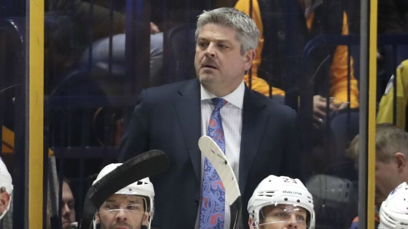 Todd McLellan watches from behind the bench during a game between the Edmonton Oilers and Nashville Predators in 2017.