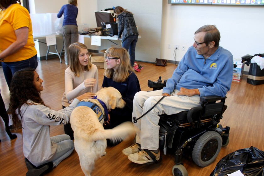 A service dog from Canine Companion & Veterans Initiative was popular with Pacific Ridge School students during their recent service day.