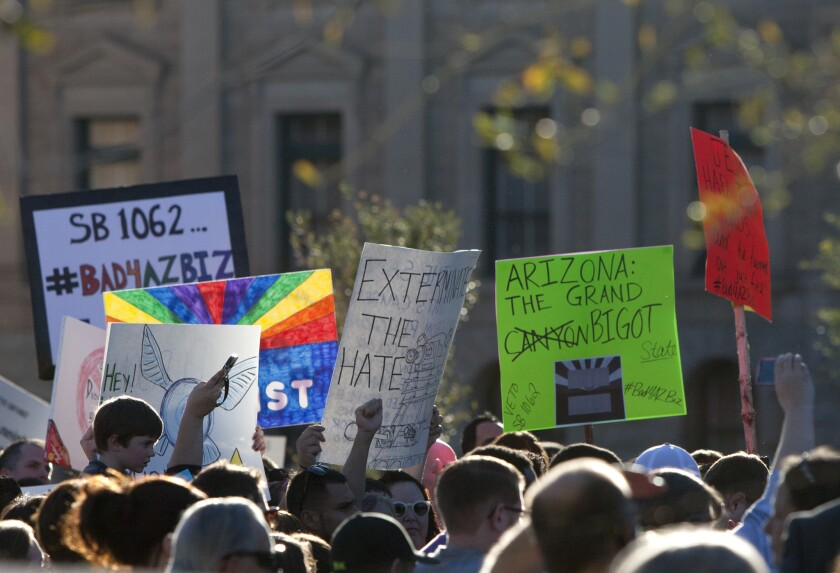 Protesters gather at the Arizona state Capitol in opposition to a bill that would allow businesses to use religious liberty as grounds for denying gays and lesbians service.