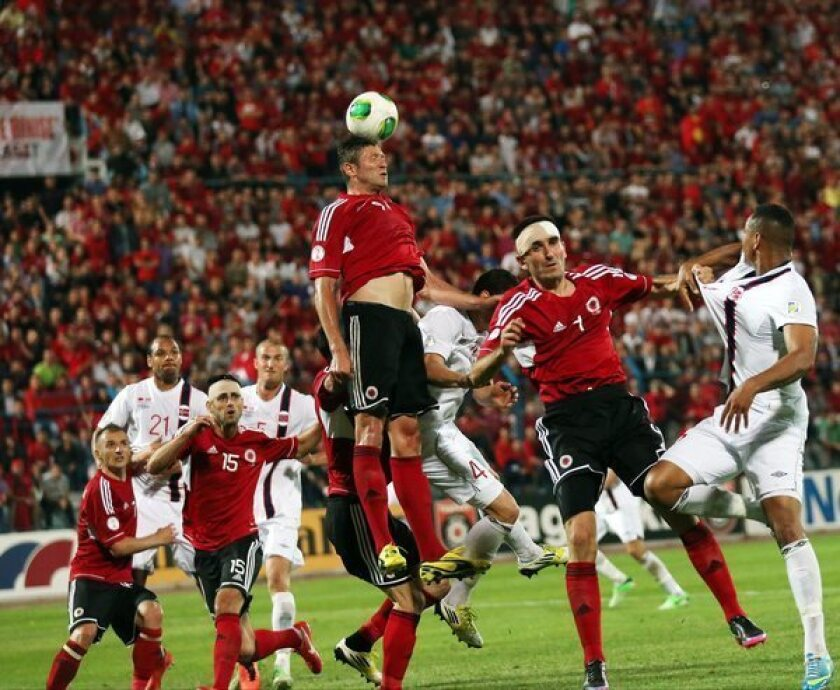 Edgar Cani of Albania heads the ball during a World Cup qualifying match against Norway.