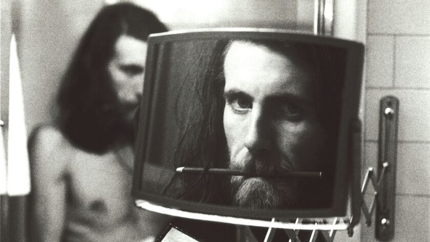 """Self-Portrait at the Plaza Hotel"" by Graham Nash is on display at the ""Taking Aim"" exhibit, which e"