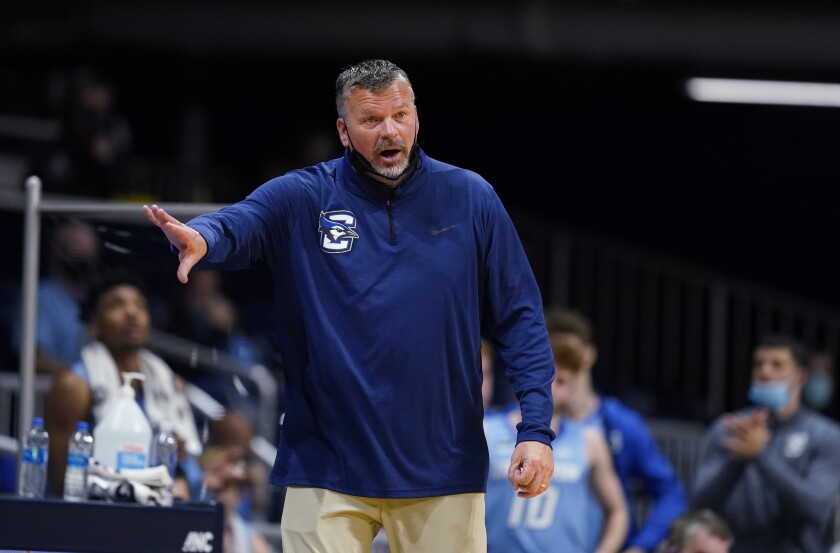 """FILE - In this Jan. 16, 2021, file photo, Creighton coach Greg McDermott watches the team during the second half of an NCAA college basketball game against Butler in Indianapolis. McDermott apologized publicly Tuesday, March 2, for using insensitive language in his postgame locker room talk with players and staff following a loss over the weekend. In a tweet, McDermott said he used a """"terribly inappropriate analogy in making a point about staying together as a team despite the loss."""" (AP Photo/Darron Cummings, File)"""