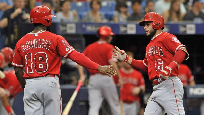 Los Angeles Angels' Brian Goodwin (18) celebrates with David Fletcher (6) after Fletcher's two-run h