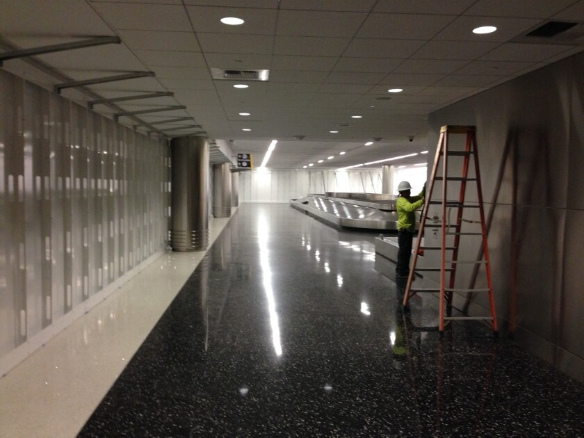 One of two baggage carousels has been walled off in the new customs inspection area of the terminal