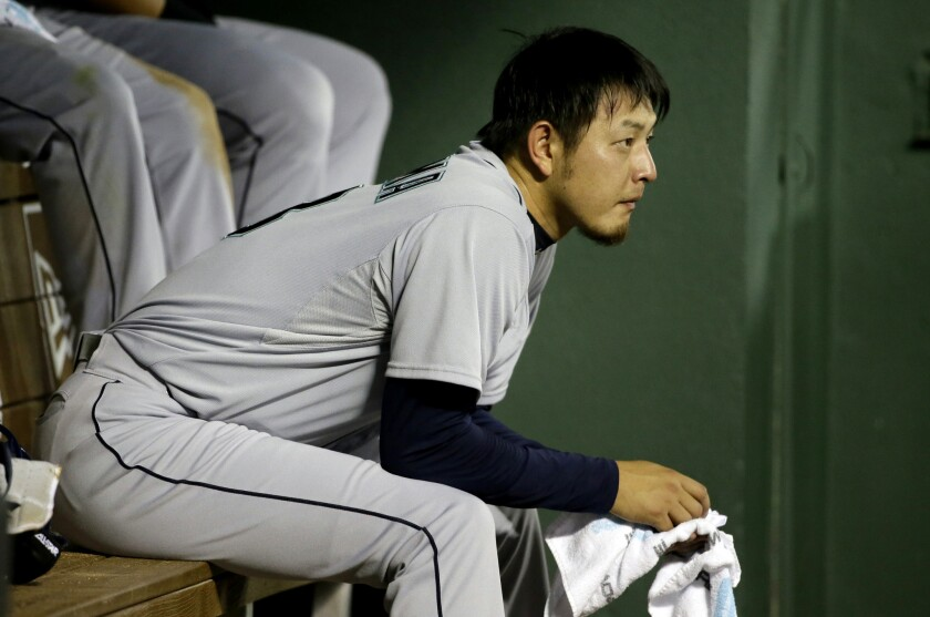 Seattle pitcher Hisashi Iwakuma sits in the dugout during a game against Texas on Aug. 18.