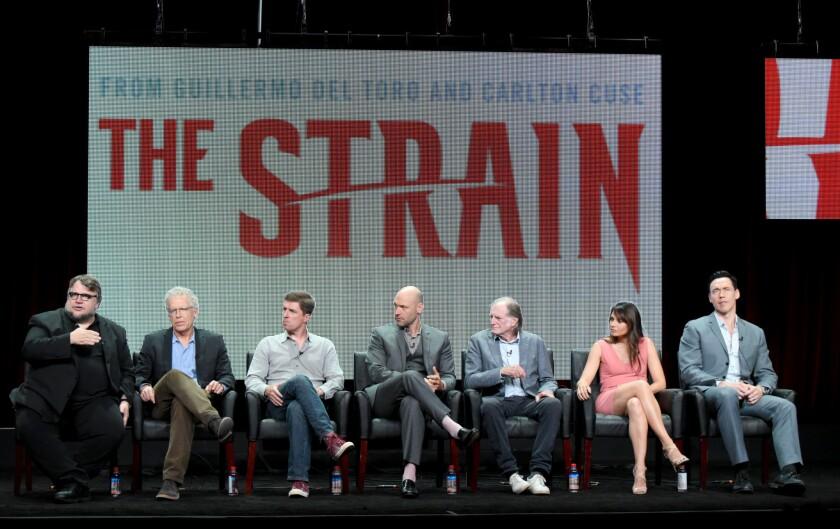 """Guillermo del Toro, left, Carlton Cuse, Chuck Hogan, Corey Stoll, David Bradley, Mia Maestro and Kevin Durand at """"The Strain"""" panel during FX's TCA presentation."""
