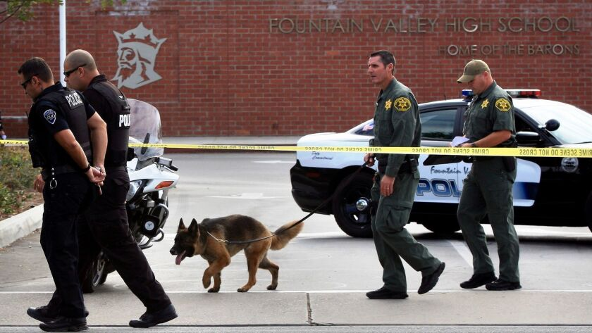 FOUNTAIN VALLEY, CA.-SEPT. 3, 2014: An Orange County sheriff's bomb-sniffing dog and Fountain Valley
