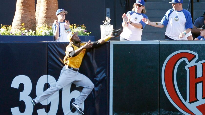 The World's Manuel Margot of the Padres makes a catch at the wall to rob USA's Carson Kelly of a home run in the sixth inning during the All-Star Futures Game at Petco Park in San Diego on July 10, 2016.