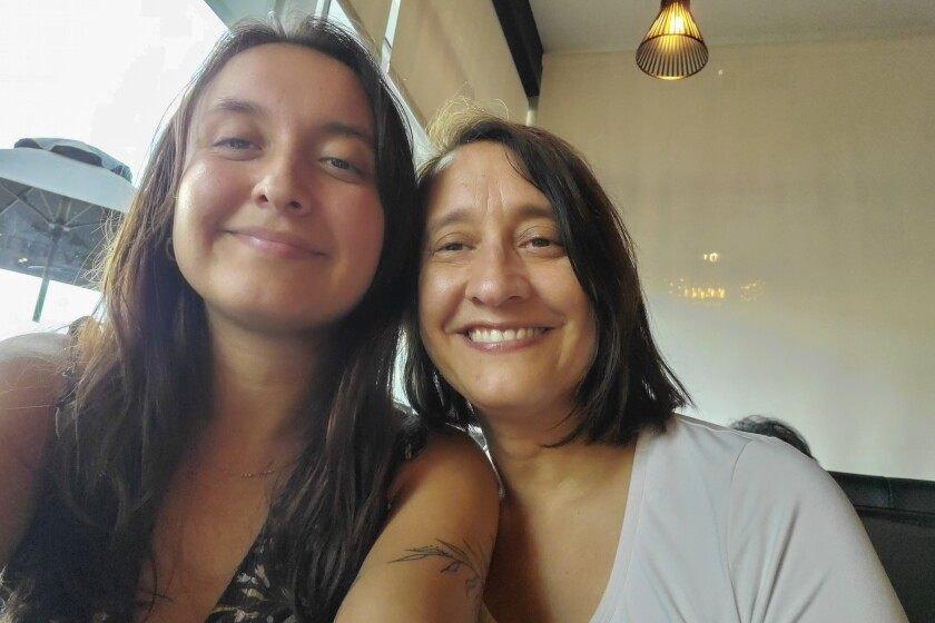 In this photo provided by Silvia Dancose of New Zealand, Dancose, right, takes a selfie with her daughter Sofia Gagnon soon after her arrival in Montreal, Canada, on Tuesday, Aug. 31, 2021. As part of its efforts to minimize the spread of the coronavirus, New Zealand requires all incoming travelers, vaccinated or not, to spend 14 days isolating in a hotel run by the military. Because demand is far outstripping supply, New Zealanders are being forced to put on hold their inalienable right to return home. (Silvia Dancose via AP)