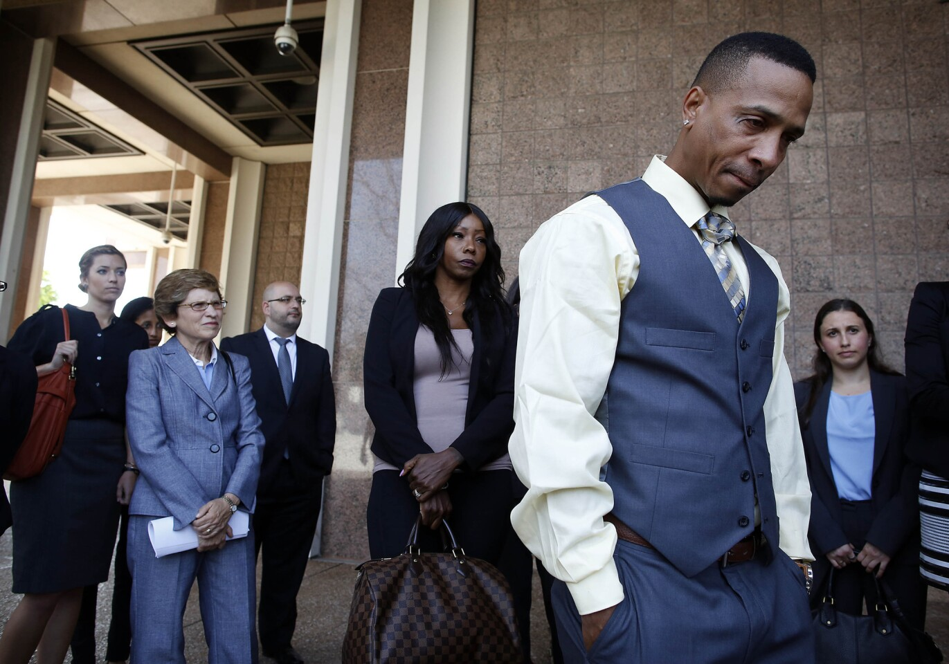 Obie Anthony, right, is surrounded by family and his legal team after being awarded more than $8 million for a wrongful conviction.
