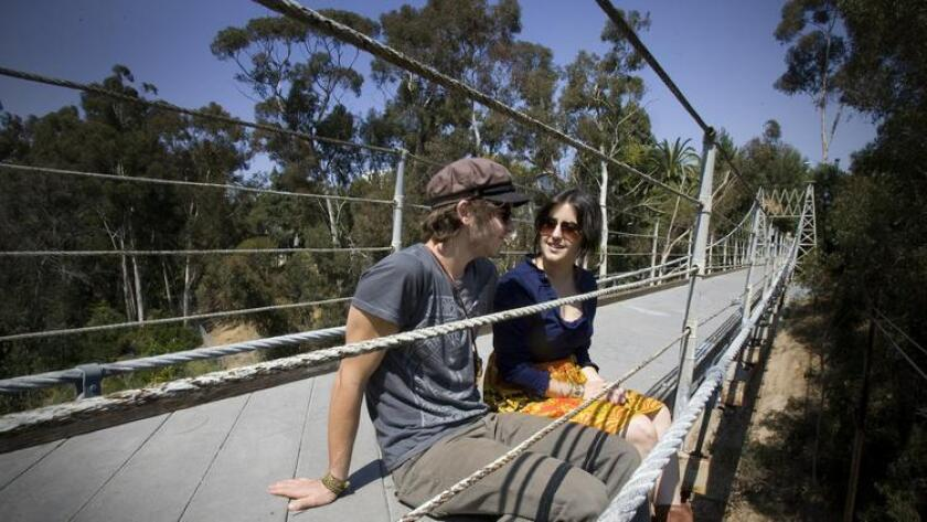 Cameron Smith and Kayla Kelley enjoy a relaxing break on the Spruce Street Bridge located in Bankers Hill of San Diego. (NELVIN C. CEPEDA/SAN DIEGO UNION)