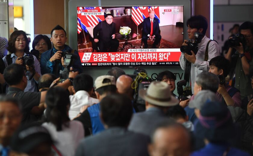A crowd of South Koreans watch live footage of the summit between President Trump and North Korean leader Kim Jong Un in Singapore at a railway station in Seoul.