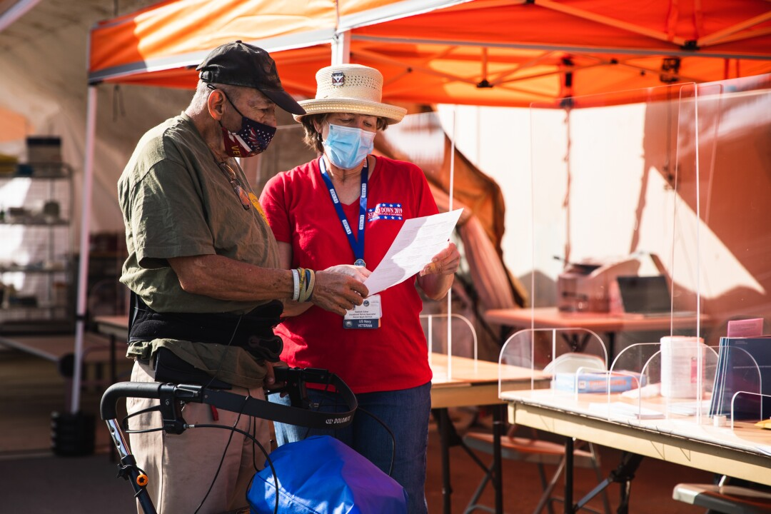 "Nadirah Sahar (right) guides U.S. Marine veteran Ray Gomez to find potential employment during the ""Stand Down"" event."