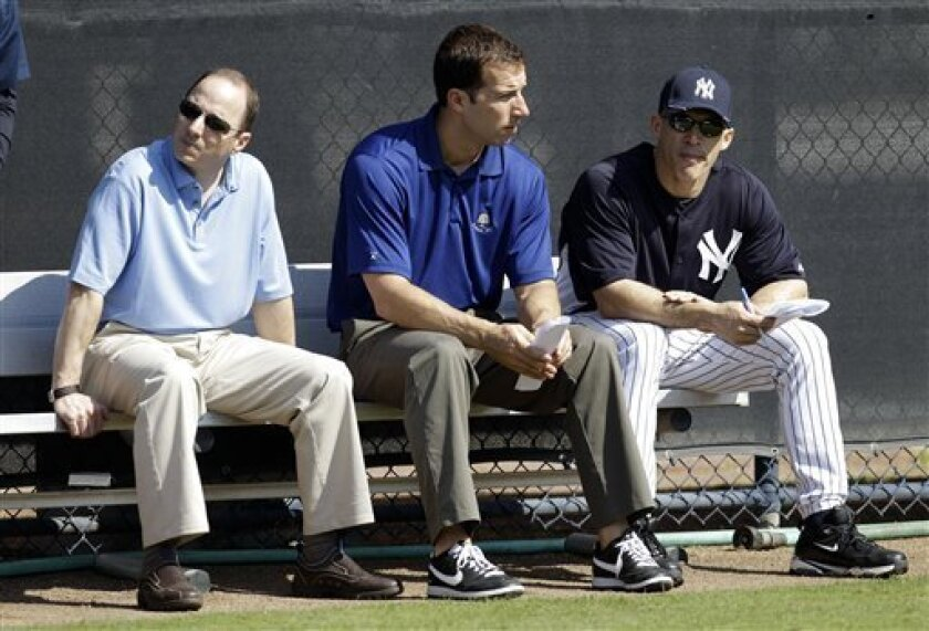 New York Yankees general manager Brian Cashman, left, Director of Professional Scouting Billy Eppler, center, and manager Joe Girardi sit in the bullpen during a baseball spring training workout Wednesday, Feb. 16, 2011, at Steinbrenner Field in Tampa, Fla. (AP Photo/Charlie Neibergall)