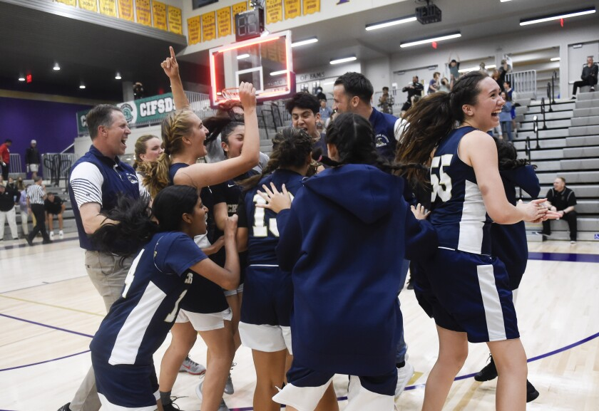 St. Joseph Academy players celebrate after beating Fallbrook 45-44 in the division III