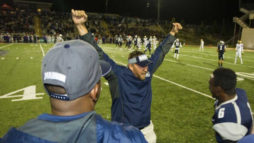 Madison coach Rick Jackson (shown celebrating a past win) guided the Warhawks to a victory over St. Augustine in a game that had been suspended Friday night because of lightning.