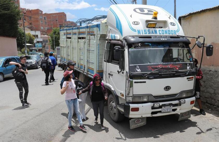 LA PAZ (BOLIVIA), Nov. 28, 2018.- A handful of activists gathers outside the municipal slaughterhouse of La Paz waiting for the trucks transporting the animals to talk to the drivers and ask them for permission to approach the truck for a few minutes and say goodbye to the animals.