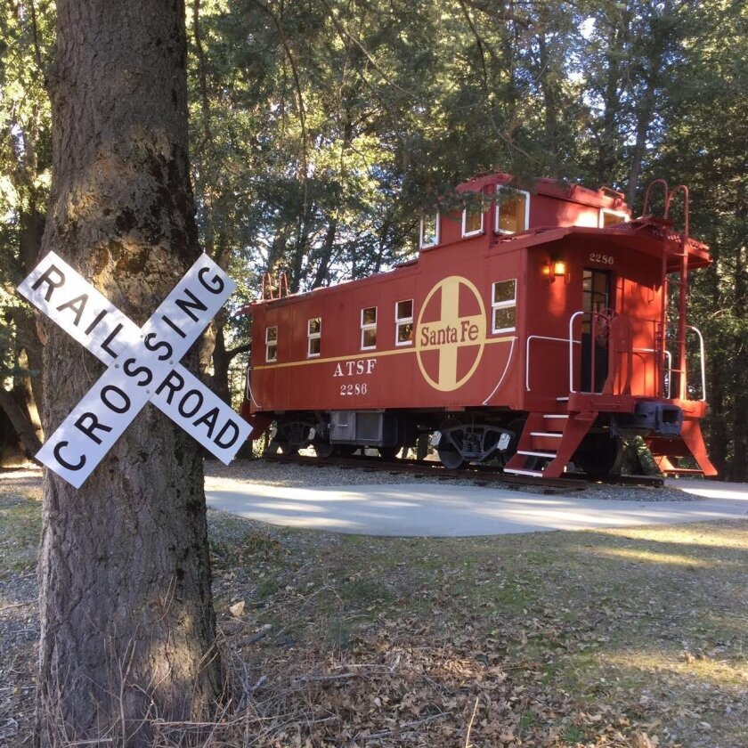 A red, 1949 caboose that once tugged behind freight cars as part of the Atchison, Topeka and Santa Fe Railway has been turned into a guest house on Palomar Mountain.