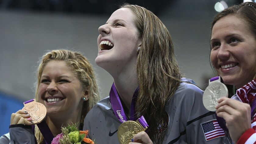 LONDON, ENGLAND, FRIDAY, AUGUST 3, 2012 – US swimmer Missy Franklin, center, shares a laugh with tea