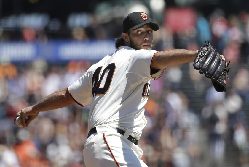 San Francisco Giants left-hander Madison Bumgarner pitches against the Chicago Cubs during the first inning of a game on Aug. 27.