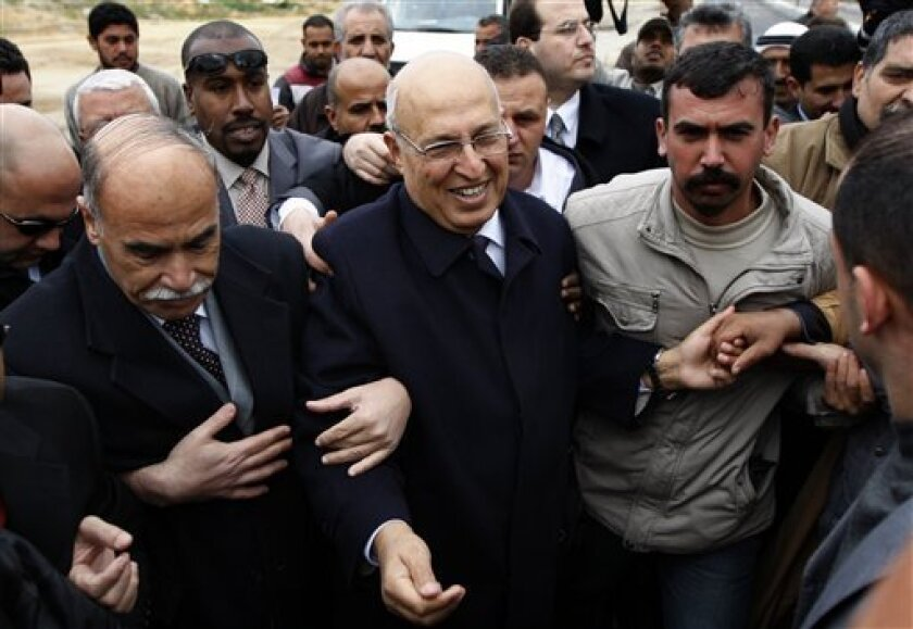 Palestinian senior Fatah leader Nabil Shaath, center, is welcomed in Beit Hanoun, near the Erez Crossing between the Gaza Strip and Israel, Wednesday, Feb. 3, 2010. A senior Fatah leader is visiting Gaza for the first time since the territory was seized by Fatah's Islamic militant Hamas rivals in 2007. Shaath, a Gaza native, said Wednesday that his three-day trip is meant to improve the atmosphere between the bitter rivals. Repeated attempts at reconciliation have failed. (AP Photo/Khalil Hamra)