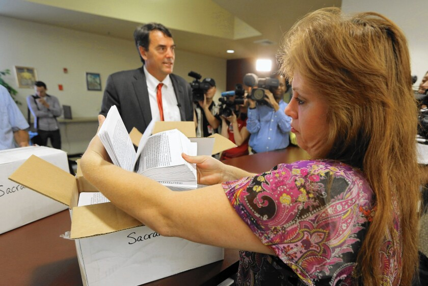Tim Draper, a Silicon Valley venture capitalist, turns in 44,000 signatures to place a measure to divide California into six states to voting officials in Sacramento County in July 2014.